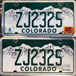 "ZJ2325: Rick Cornelison (Walden, CO). In the early 2000s, ""greenies"" in rougher shape were pulled off the road, but in the first few years of the new century, the state of Colorado gave motorists with these old plates the option to have them remade on the current vanity base should they wish to keep their numbers. You'll notice that on the standard 77-00 passenger page, ZJ-2326 (green plate, one number higher) is displayed. This is the only such remade Jackson set I've seen in use or otherwise."